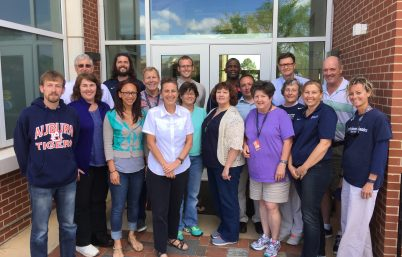 Group photo of 25 faculty members from School of Kinesiology