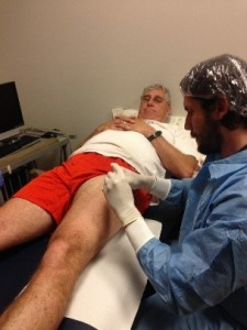 Dr. Mike Roberts performing a leg muscle biopsy in the left quadricep of research subject.