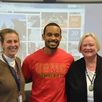 Kinesiology School Director Dr. Mary Rudisill, Khalil Lee, and College of Education Dean Betty Lou Whitford welcome the students to Auburn. Lee recently defended his dissertation and will receive his Ph.D in Exercise Physiology in December.