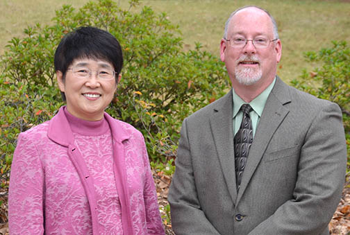 Dr. Suhyun Suh, Associate Professor in Special Education, Rehabilitation, and Counseling, left, with Dr. Andrew Gillespie, Assistant Provost for International Programs at Auburn University, right.