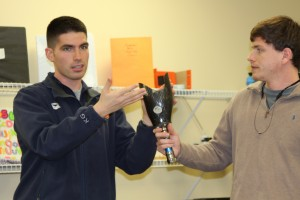 Dr. Games showing prosthetic