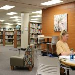 Student utilizes the group study area within the LRC Commons.