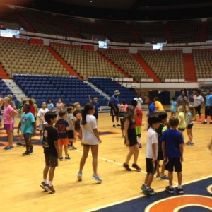 Elementary campers doing zumba in gym for exercise adherence.