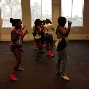 Junior high students dancing zumba.