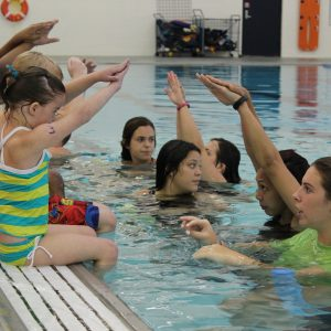 campers learning how to dive into the pool