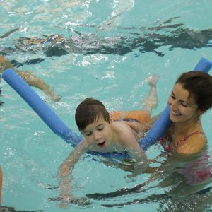 boy with disability learning how to swim