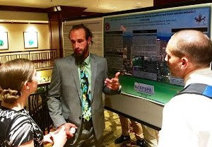 grad student Ford Dyke presenting poster