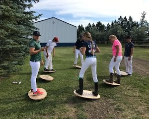 polo players on balance boards