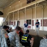 Outreach talking to soldiers