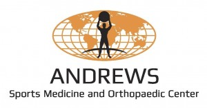 Andrews Sports Medicine and Orthopaedic Center orange globe with black figure holding ball overhead