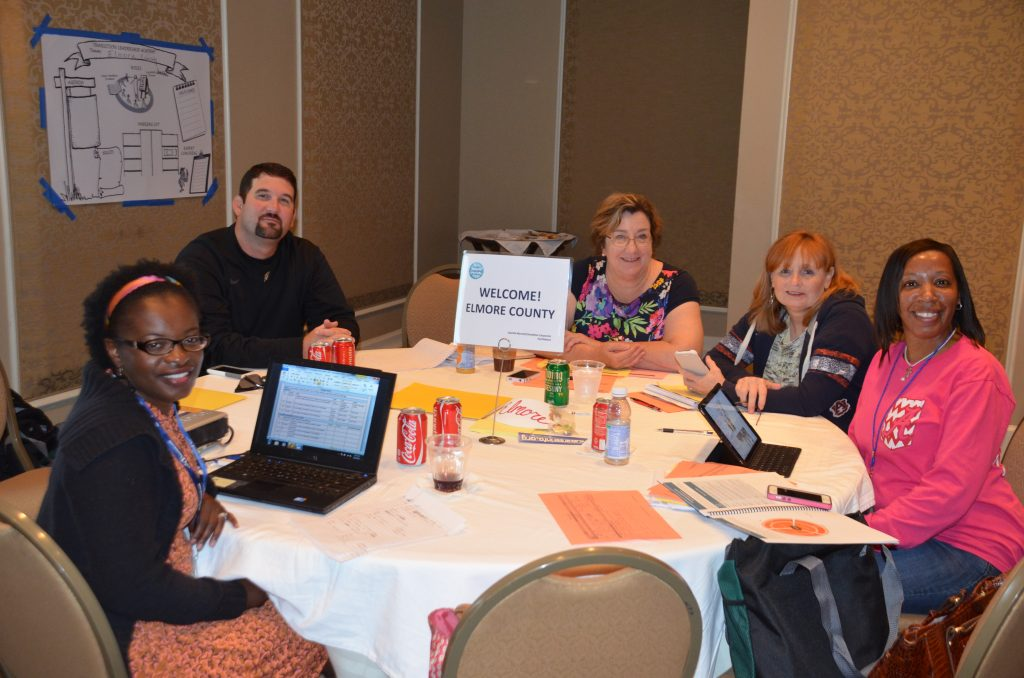 Teachers collaborating around a table