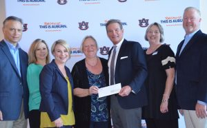 Representatives from Boeing Corporation were in Auburn recently to present a check to support Madison County Afterschool programs. On hand were College of Education Dean Betty Lou Whitford, Paul Morin, who directs the program, and Lynne Patrick, director of Auburn's Truman Pierce Institute.