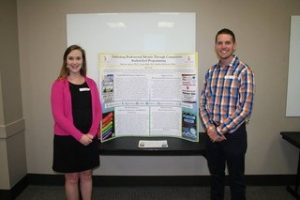 Kaitlin McIntosh and Justin Maki at poster presentation.