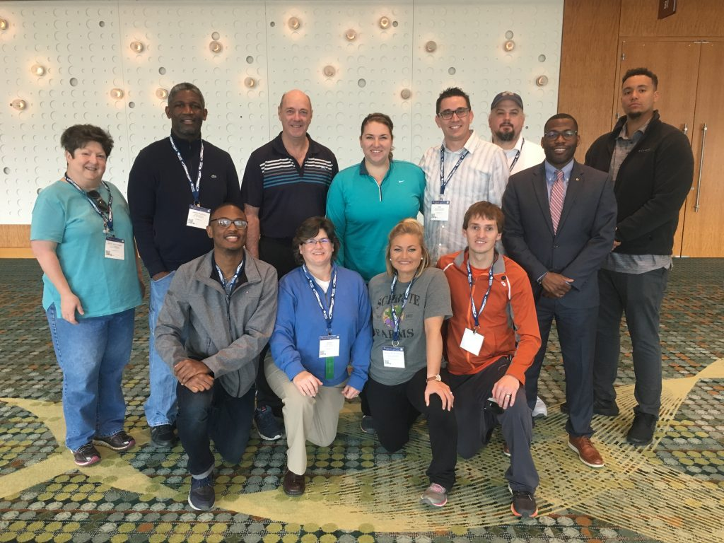 "Pictured back row (left to right): Alice Buchanan, Ph.D.; Jared Russell, Ph.D.; Peter Hastie, Ph.D.; Nikki Hollett; Ben Miedema, Andy Stringfellow, Korey Boyd, Cory Dixon. Front row (left to right): Jerraco Johnson, Sheri Brock, Ph.D.; Jessica Richards, and Jeffery ""Kurt"" Ward."