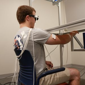 research participant reaching out in 3-D space