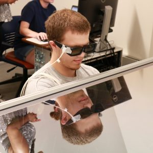 research participant wearing 3-D glasses