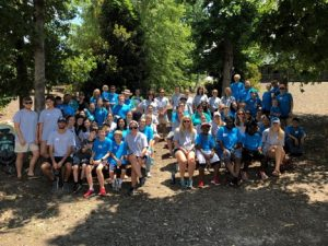 Camp photo with families and volunteers