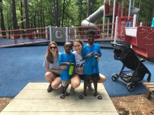 Kayla McInroy (left) and Brenna McIlroy (right) with two campers