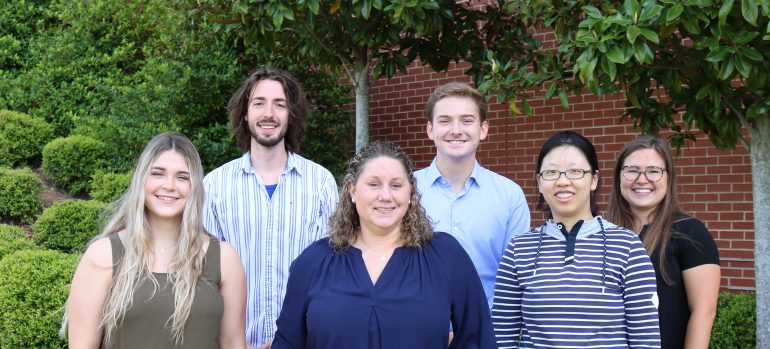 Group photo of lab members outdoors