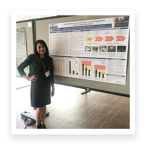 Dulce posing with her research poster