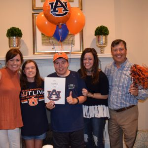 Bradley and family after opening his acceptance letter to Auburn.