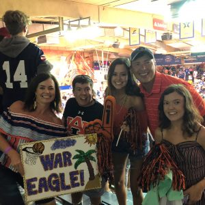Katie and her family at an Auburn Basketball Game.