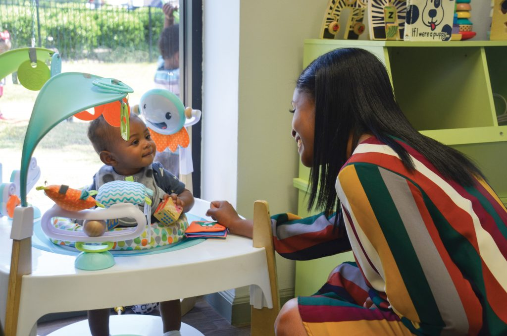 McAlpin interacting with infant student