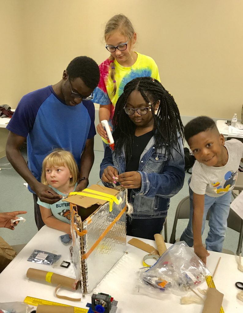 Children building with glue and cardboard