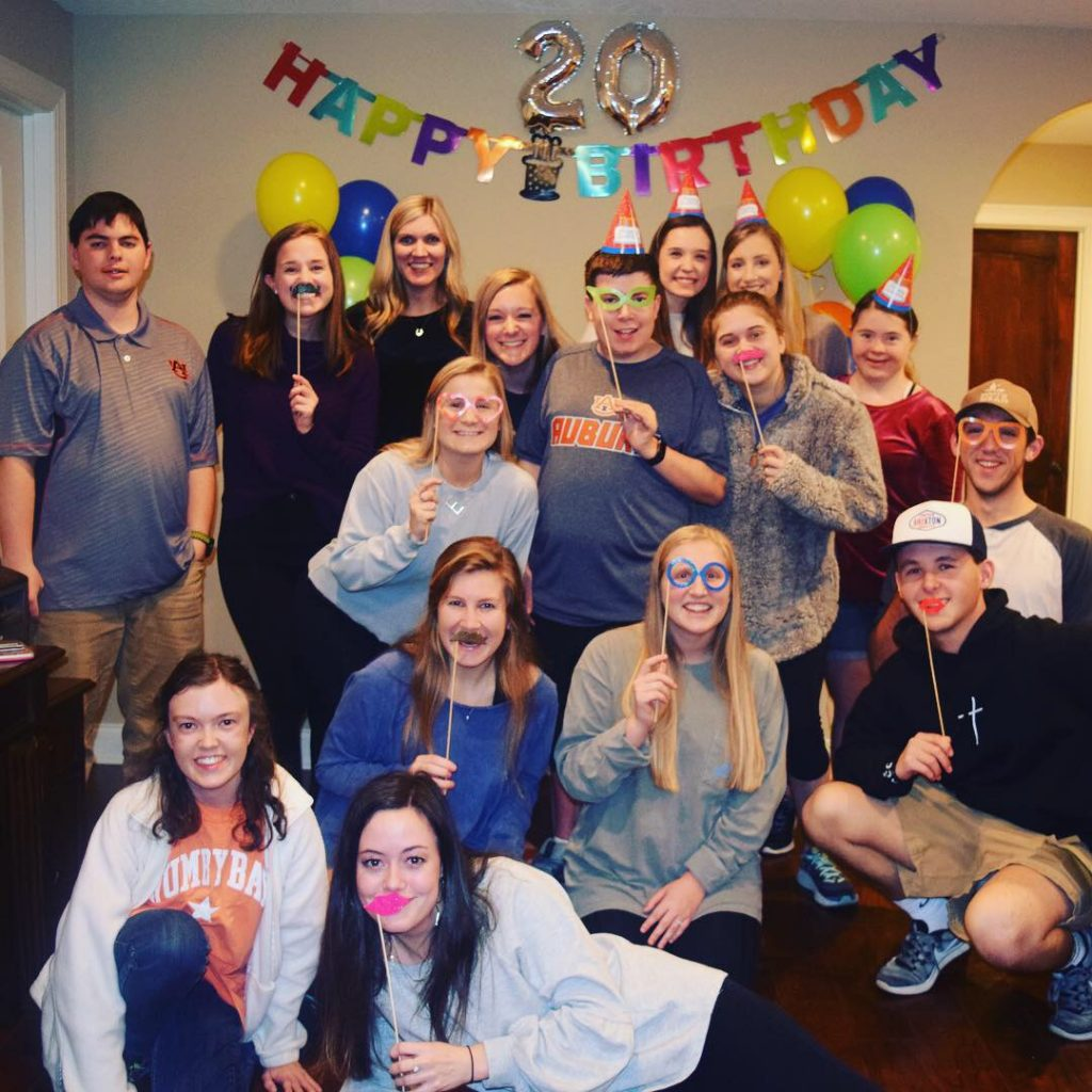 Bradley at his 20th birthday party with friends and cohort members