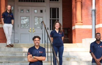 Neurovascular Physiology Laboratory Austin Robinson and lab personnel on steps of Samford Hall