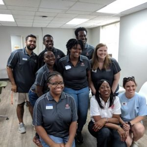 Ms. Juanita Graham, CEO of ASE, poses with the TCI counselors and Engineering Outreach staff. Front row (L to R): Angel Barganier, Juanita Graham, Jessica Taylor Middle row (L to R): Essence' Chandler, Jaylin Hubber, Sydney Riley Back row (L to R): Devon Vafai, Jesse Pina Carvalho de Melo, Jailin Sanders