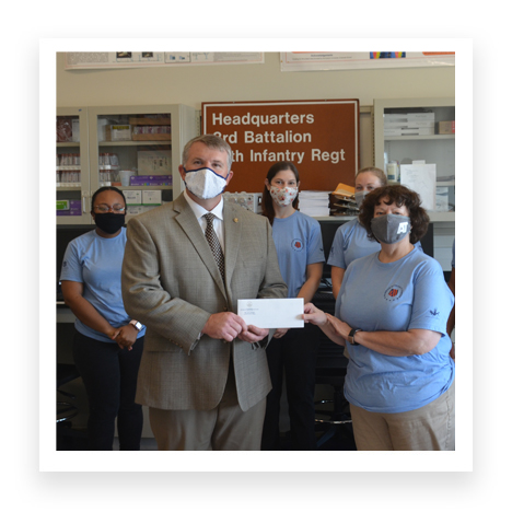 Lovvorn visits Warrior Research Center, presents check to support its work with firefighters