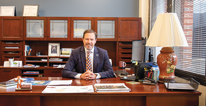 Jeffrey Fairbrother sitting at his desk